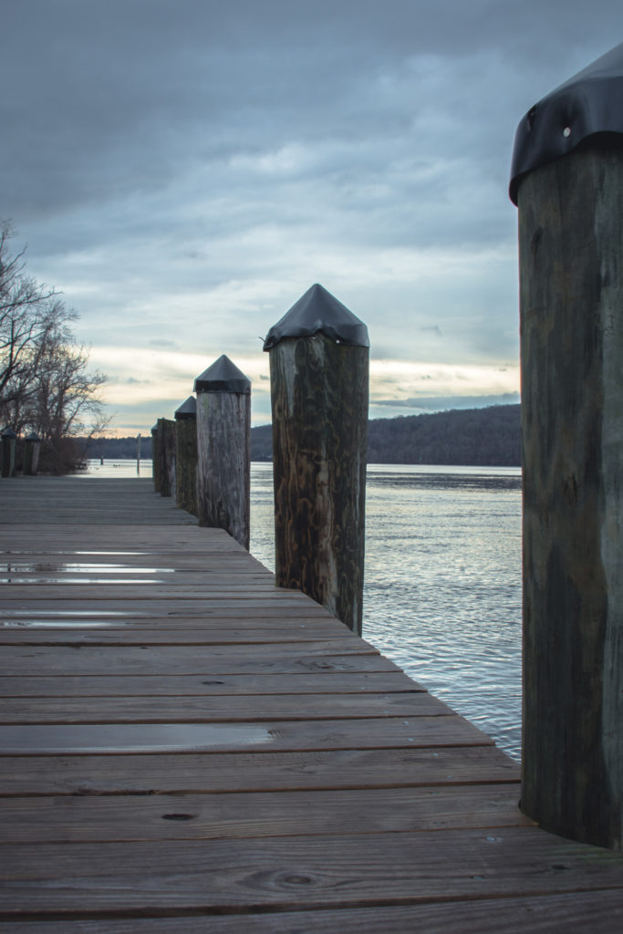 dock at the goodspeed opera house in east haddam, connecticut during the winter, photographed by jamie bannon photography.