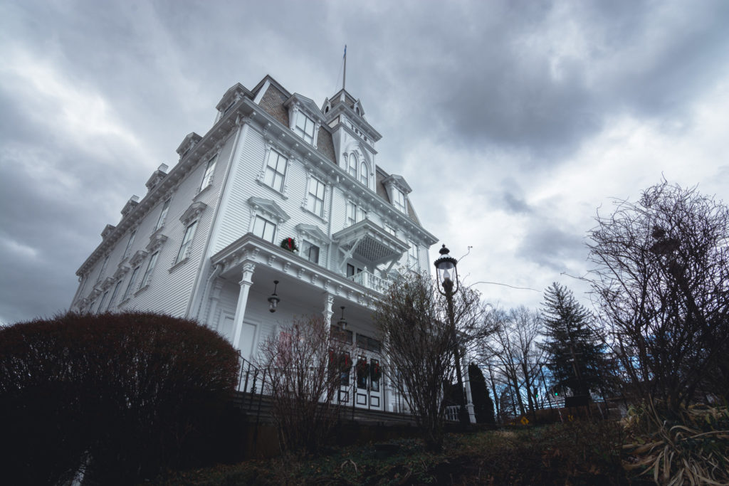 goodspeed opera house in east haddam, connecticut under a dramatic cloudy winter sky, photographed by jamie bannon photography.