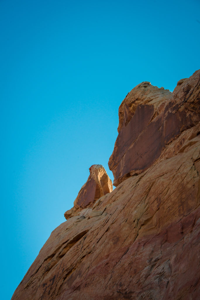 red rocks sit against a blue sky at valley of fire state park in nevada, photographed by jamie bannon photography.