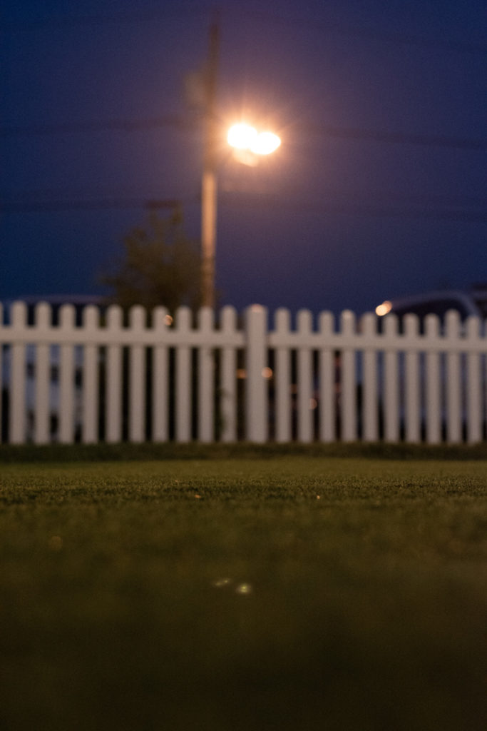 street lamp with white picket fence and astroturf, photographed by jamie bannon photography.
