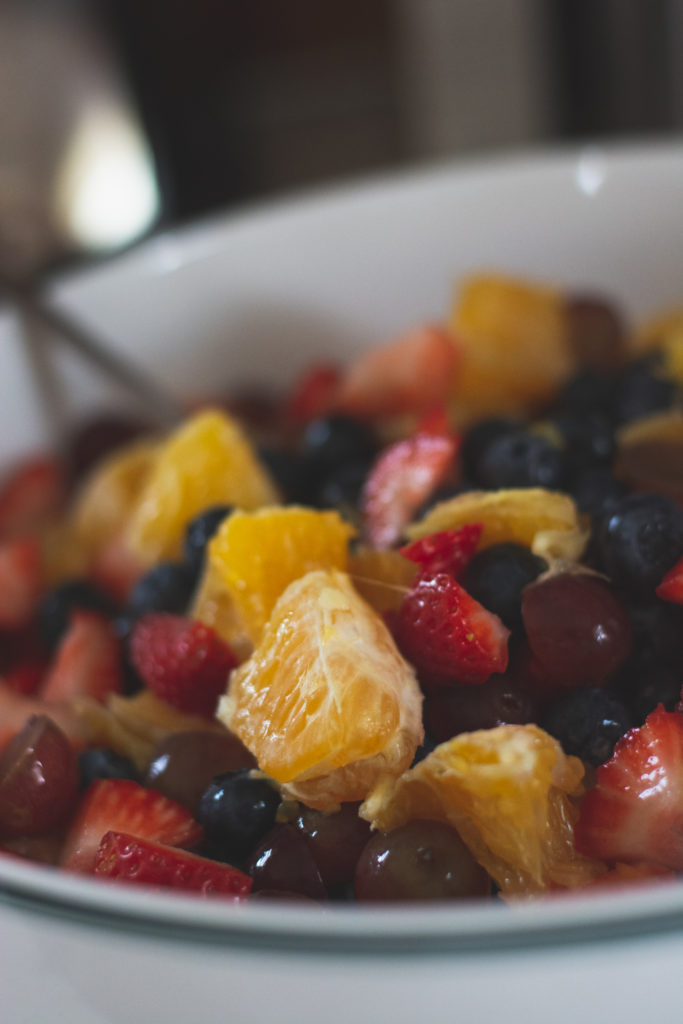 detail of a colorful bowl of fruit salad, photographed by jamie bannon photography.