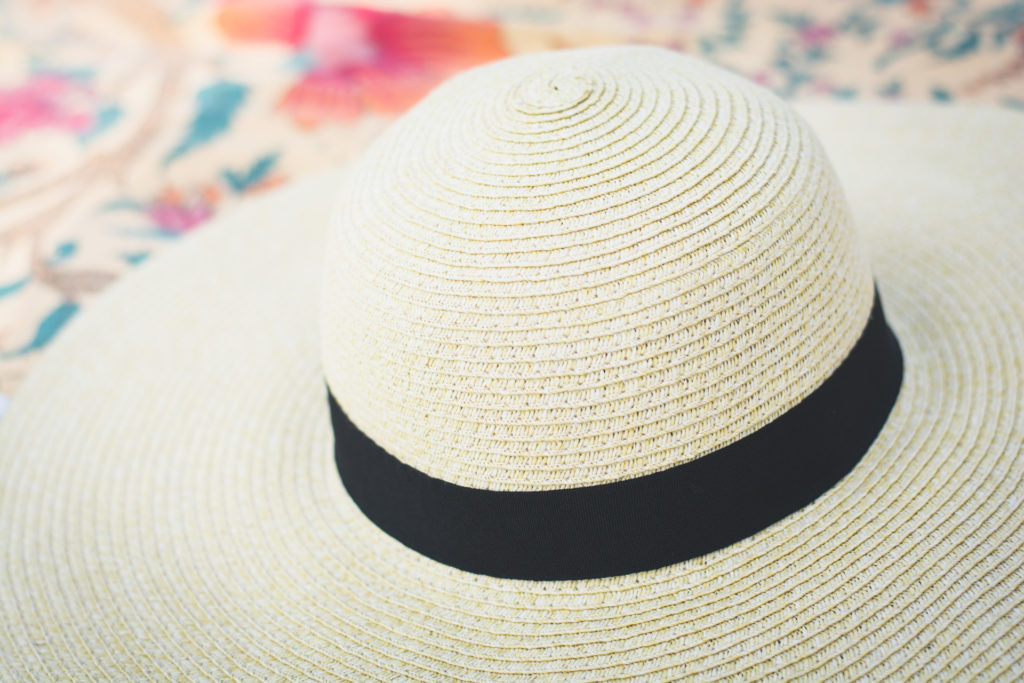 detail of a wide brimmed, straw beach hat, photographed by jamie bannon photography.