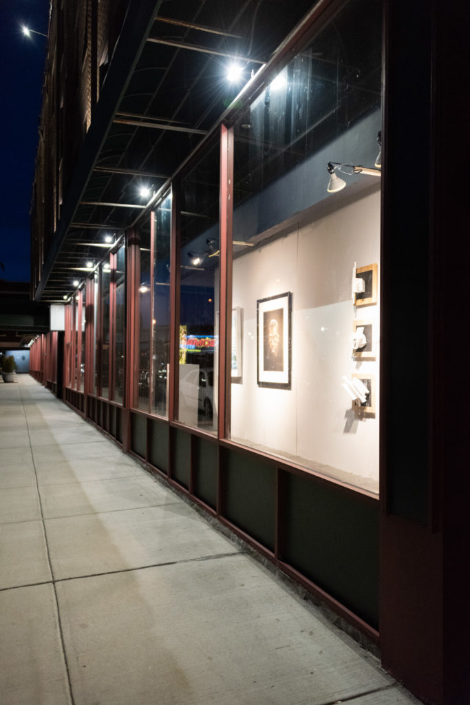 a art exhibit installed in previously empty storefronts in downtown hartford, connecticut, photographed by jamie bannon photography.