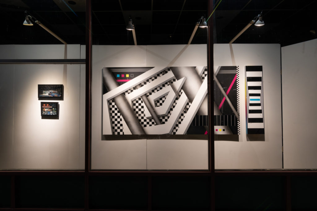 an art exhibit lit up at night, occupying the previously empty storefront windows of downtown hartford, connecticut, photographed by jamie bannon photography.