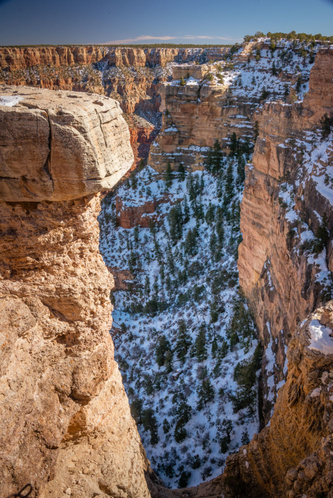looking down into the grand canyon covered in snow in january, photographed by jamie bannon photography.