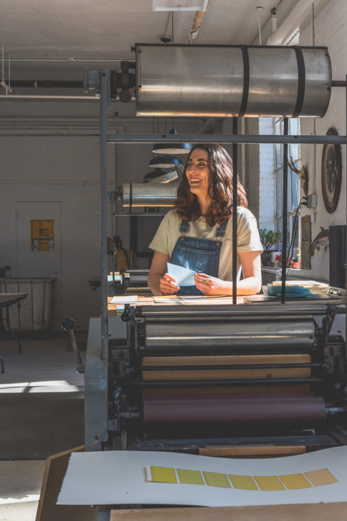 portrait of a printer working in her printmaking studio in west hartford, connecticut, photographed by jamie bannon photography.