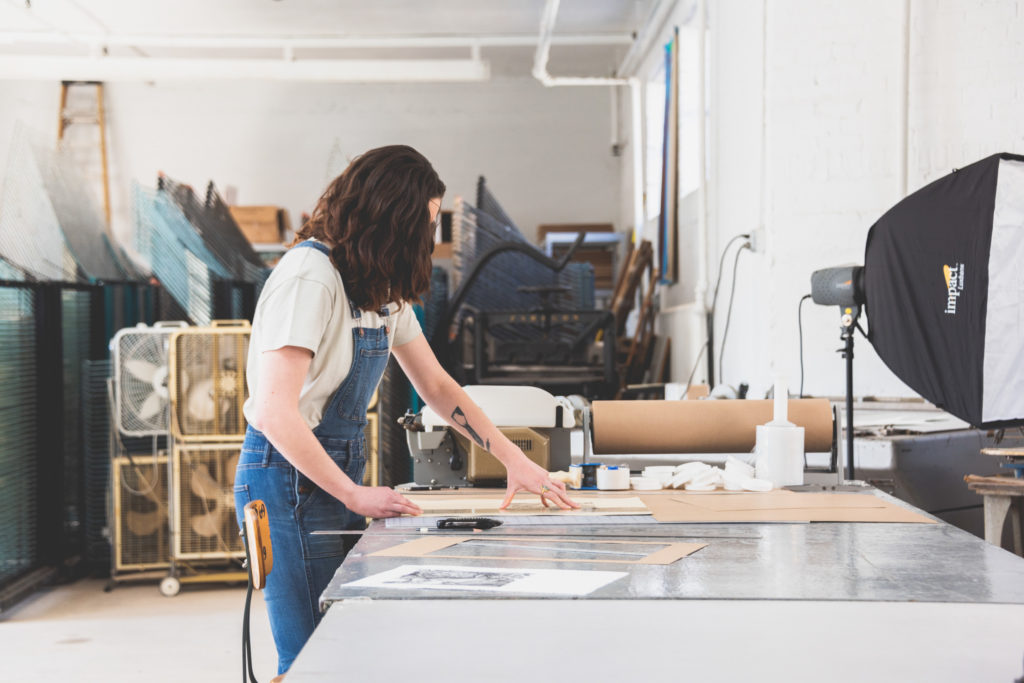 a printer works in her printmaking studio in west hartford, connecticut, photographed by jamie bannon photography.