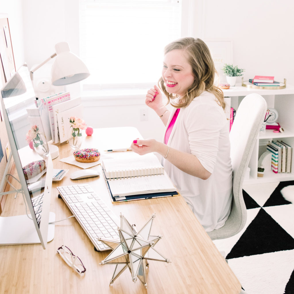 female entrepreneur dancing at her desk, as part of a personal branding shoot, photographed by jamie bannon photography.