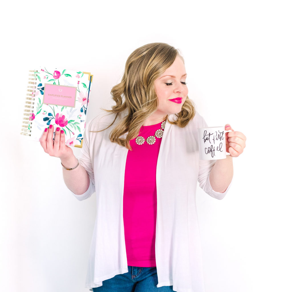 "a female entrepreneur poses with her simplified planner and ""but first, coffee"" mug, as part of a personal branding shoot by jamie bannon photography."