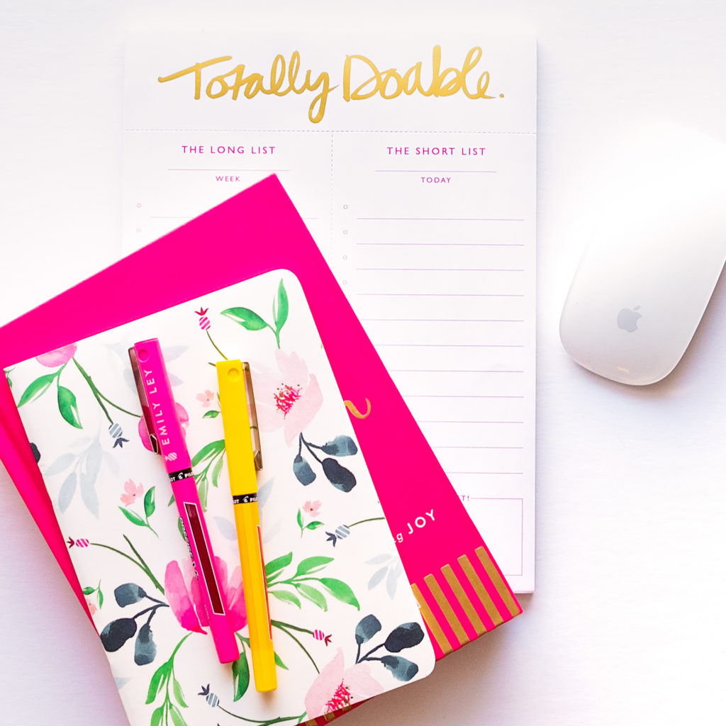 flat lay of a to-do list, planner, book, colorful pens, and apple mouse, as part of a branding shoot by jamie bannon photography.