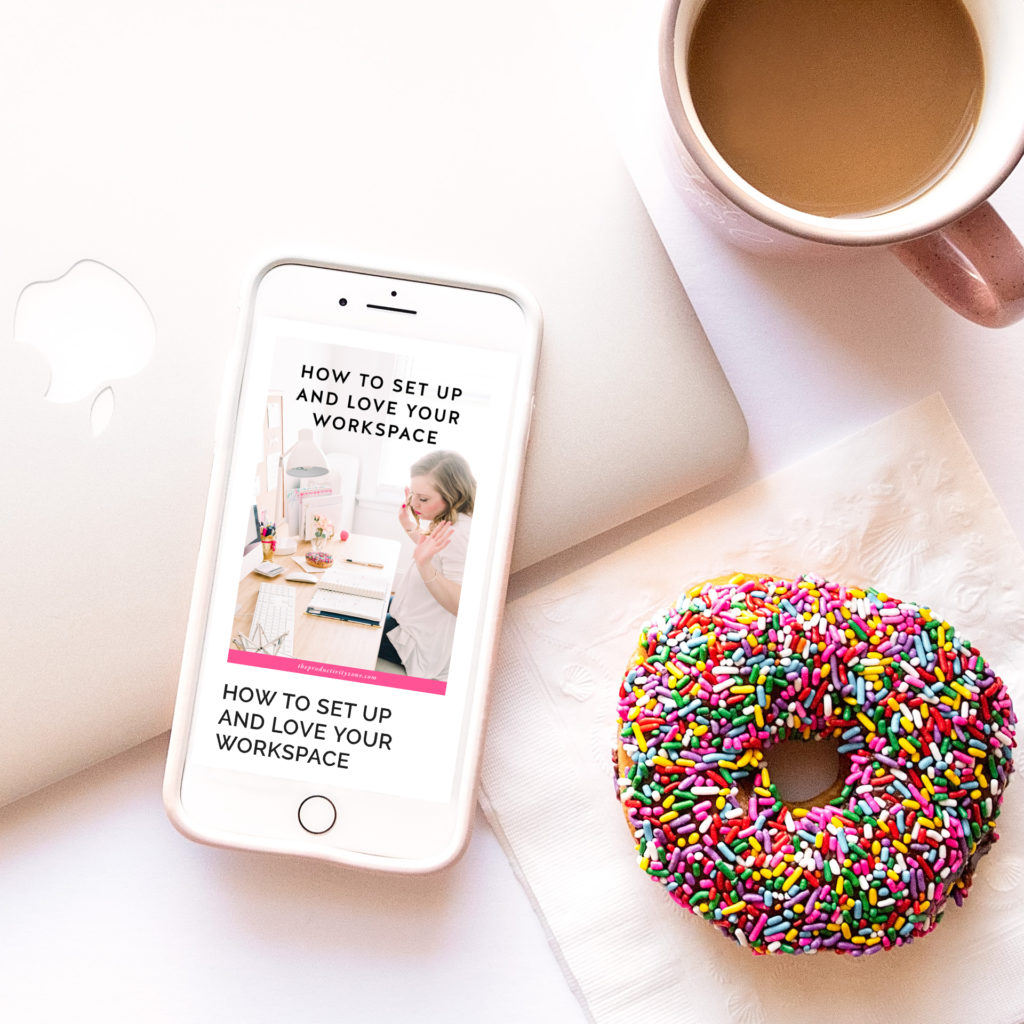 flat lay of an imac, iphone, cup of coffee, and chocolate frosted doughnut with sprinkles, as part of a business branding shoot for the productivity zone by jamie bannon photography.