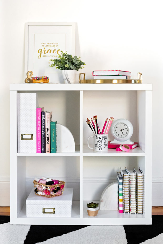 white shelves with colorful décor in the office of a female entrepreneur, as part of a personal branding shoot by jamie bannon photography.