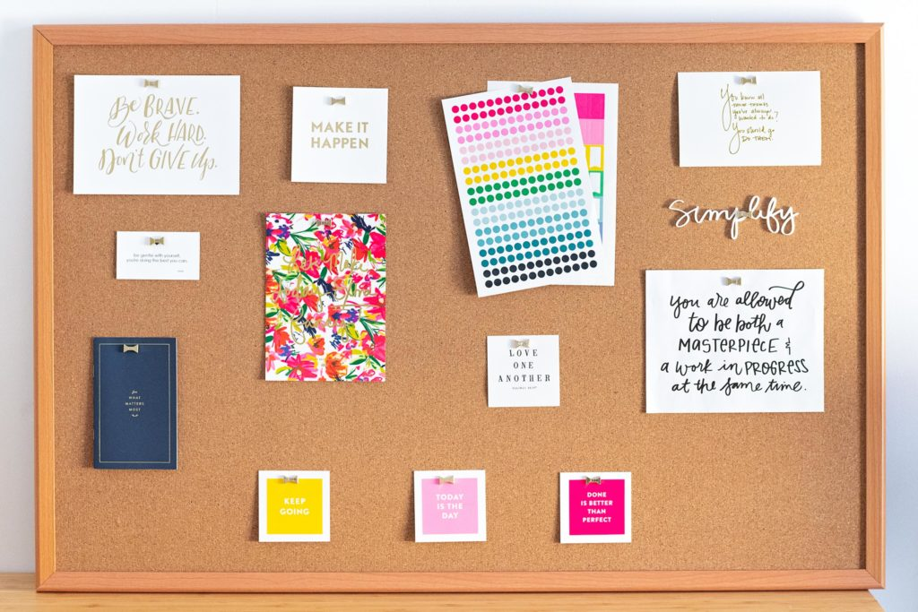 a cork board full of motivational quotes and inspirational sayings in the office of a female entrepreneur, photographed as part of a personal branding shoot by jamie bannon photography.