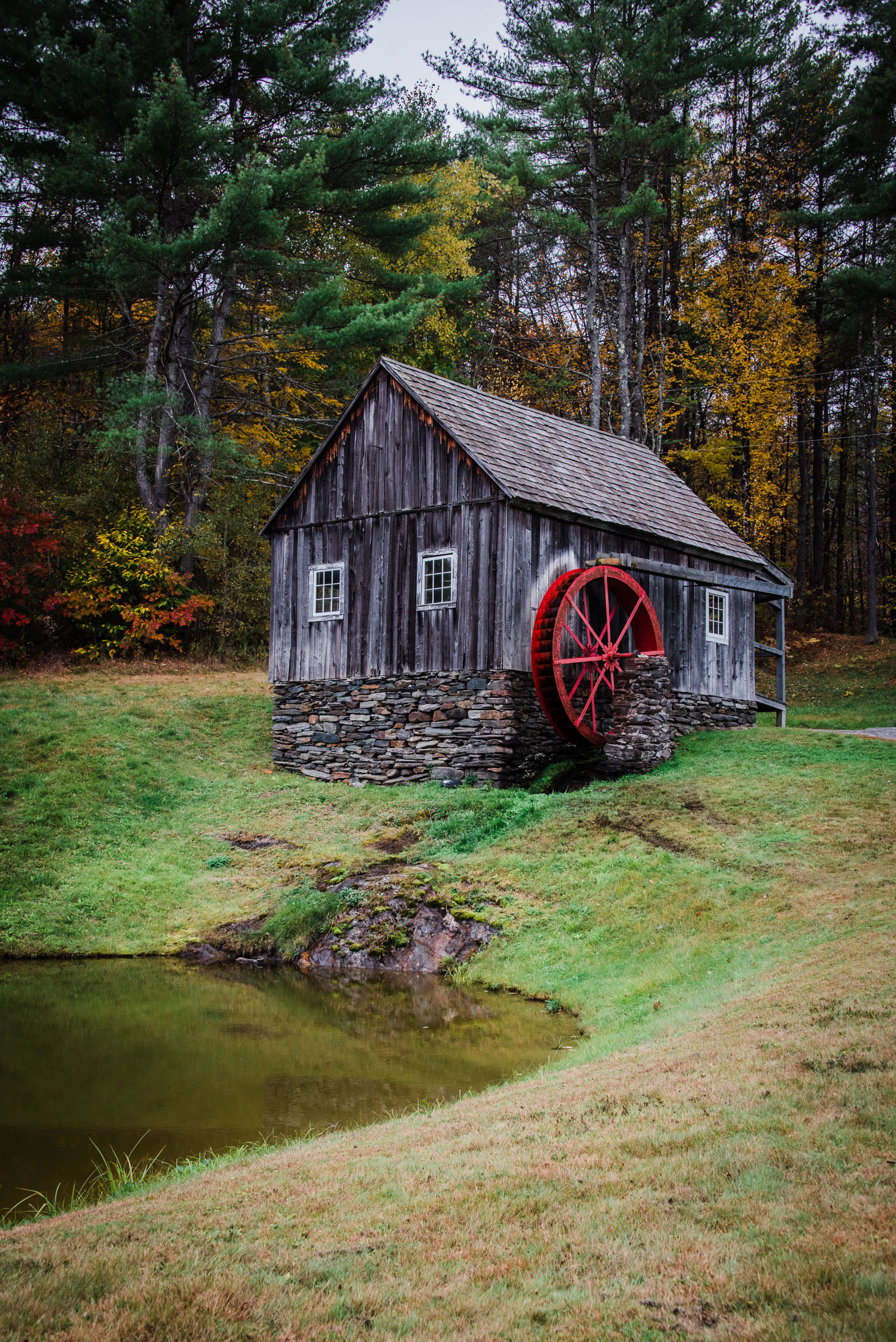 water wheel in the fall in vermont, photographed by jamie bannon photography.