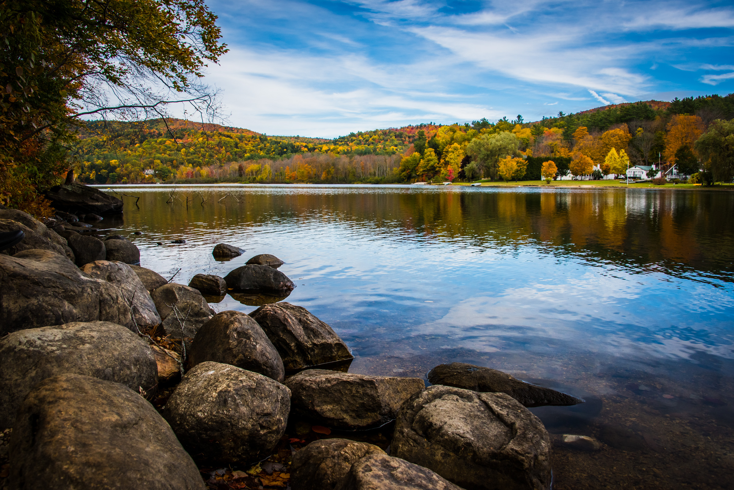 vermont landscape with colorful fall foliage reflecting in a lake, photographed by jamie bannon photography.