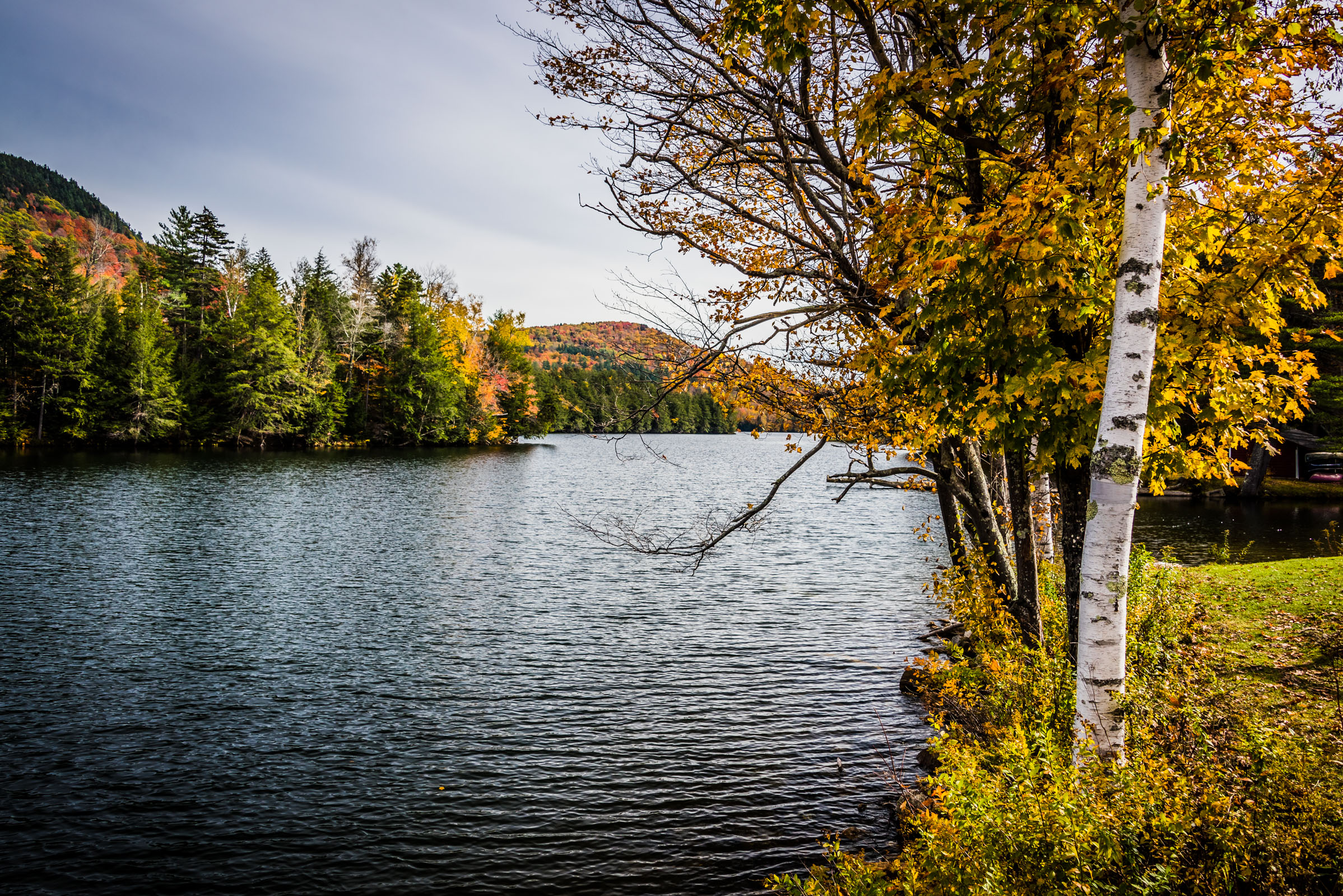 vermont landscape with colorful fall foliage by a lake, photographed by jamie bannon photography.