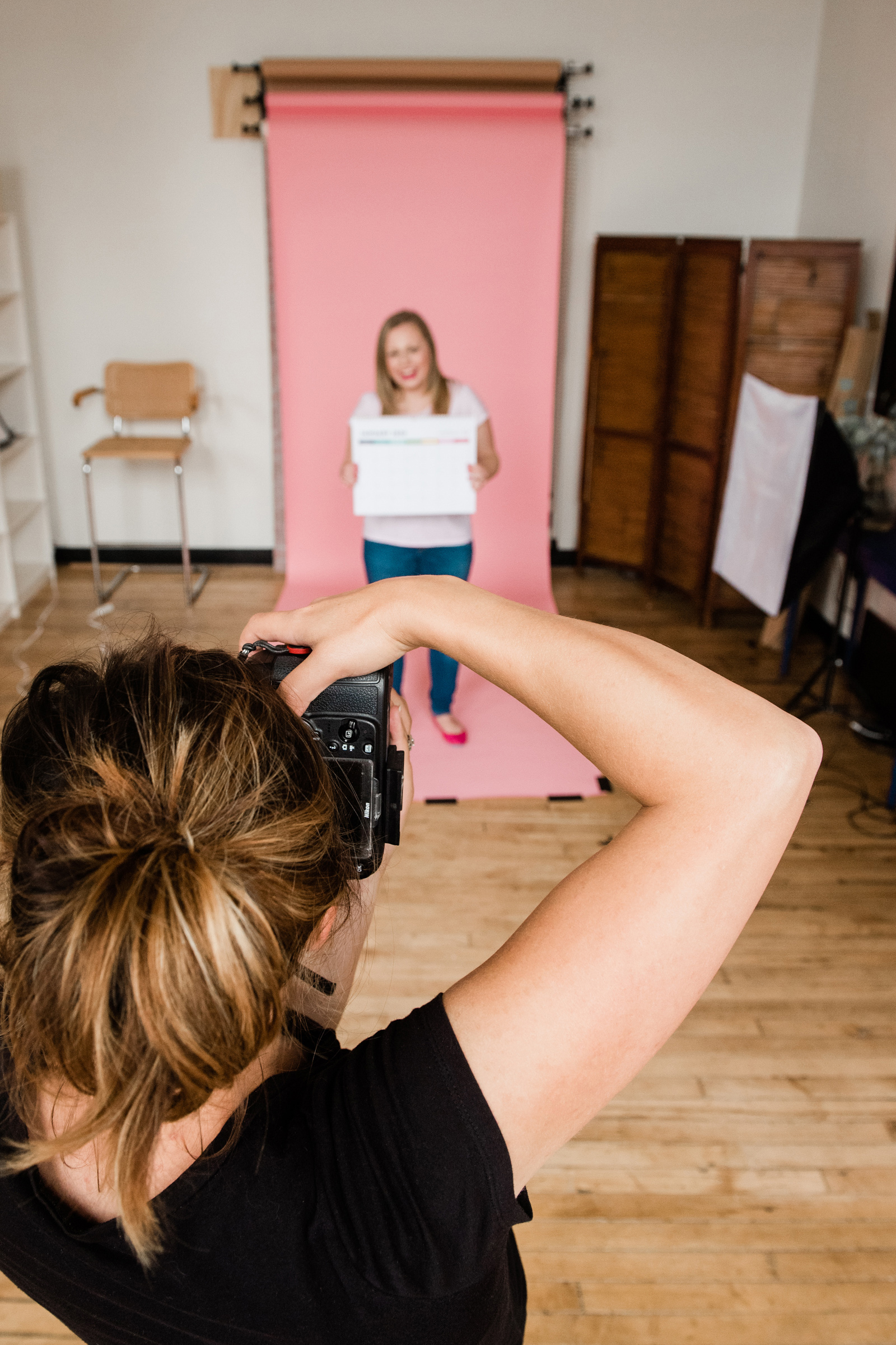behind the scenes shot of jamie bannon photographing a brand shoot, photographed by chistina wesley photography.