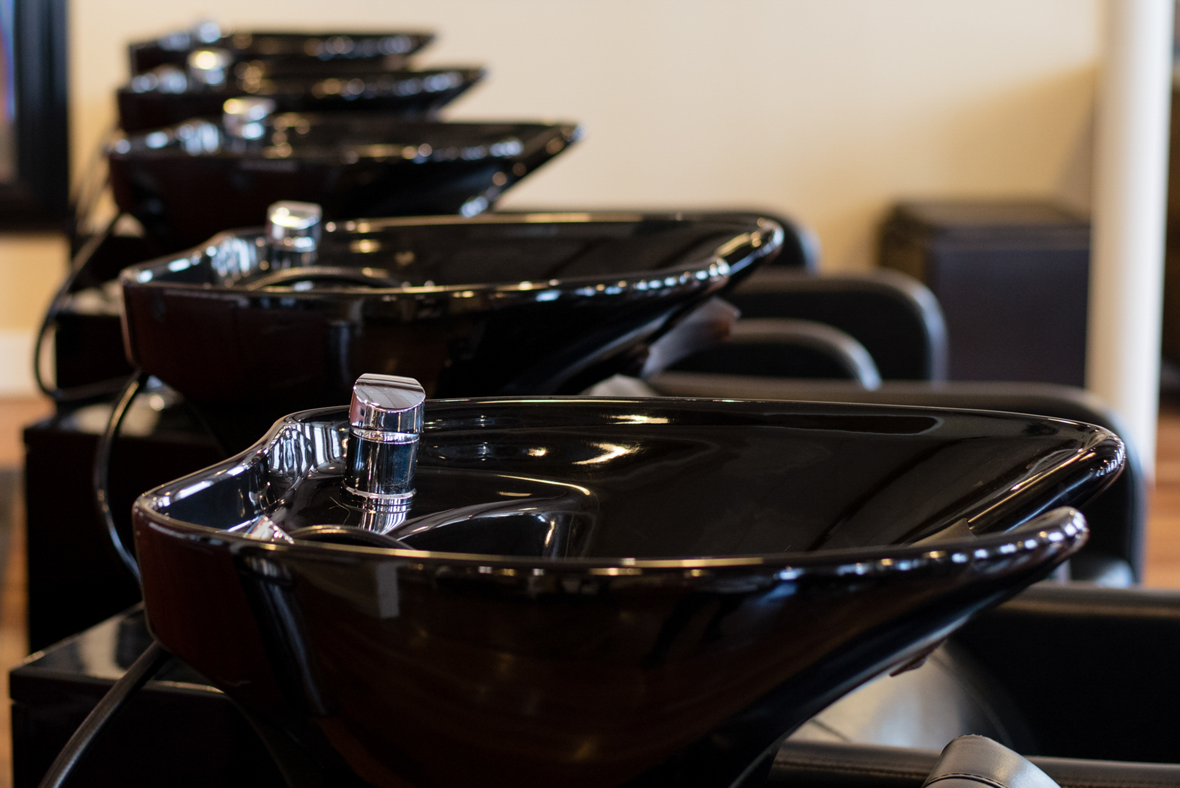 a row of salon sinks, photographed by jamie bannon photography.