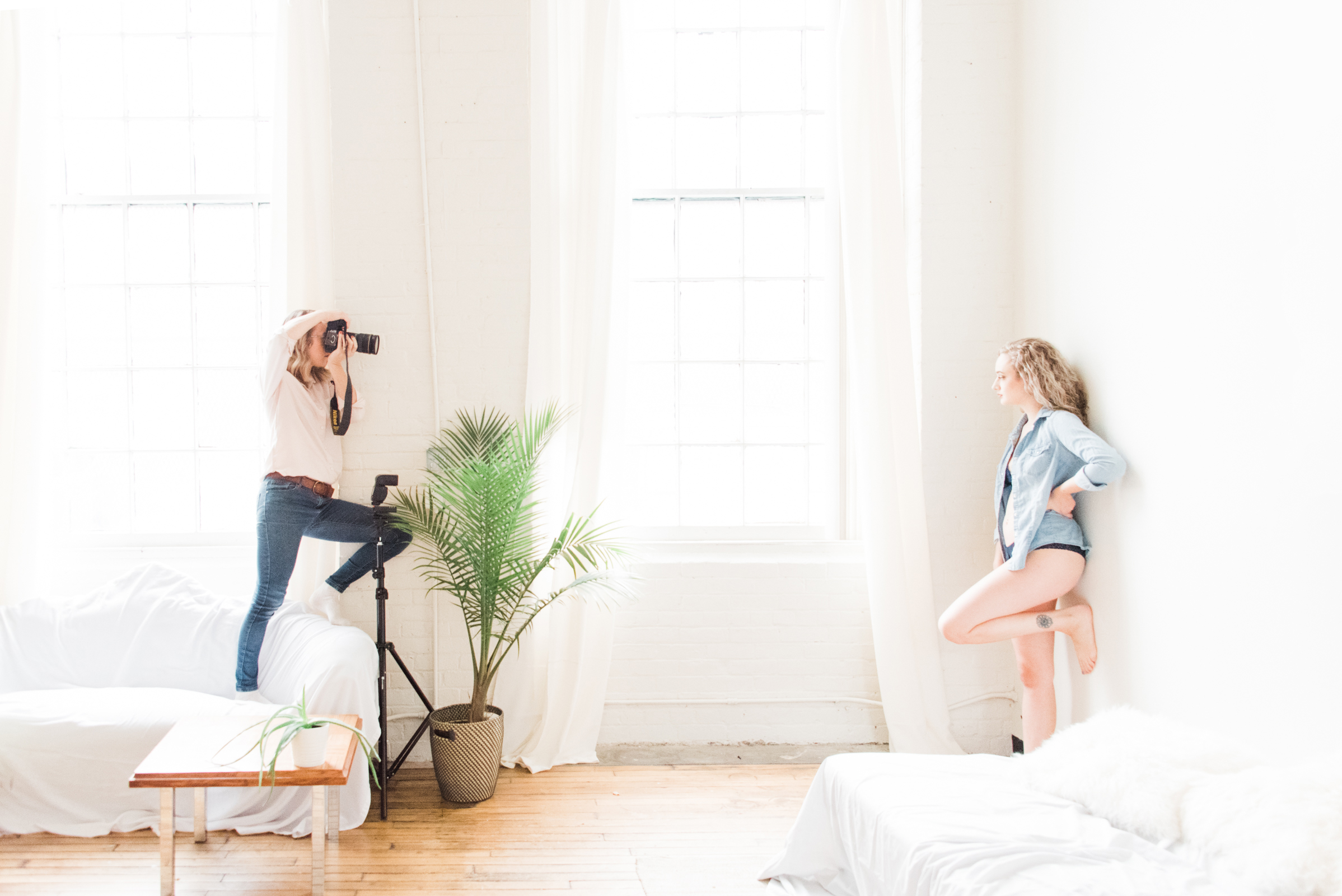 a boudoir photographer shoots her client, photographed as part of a behind the scenes brand shoot by jamie bannon photography.