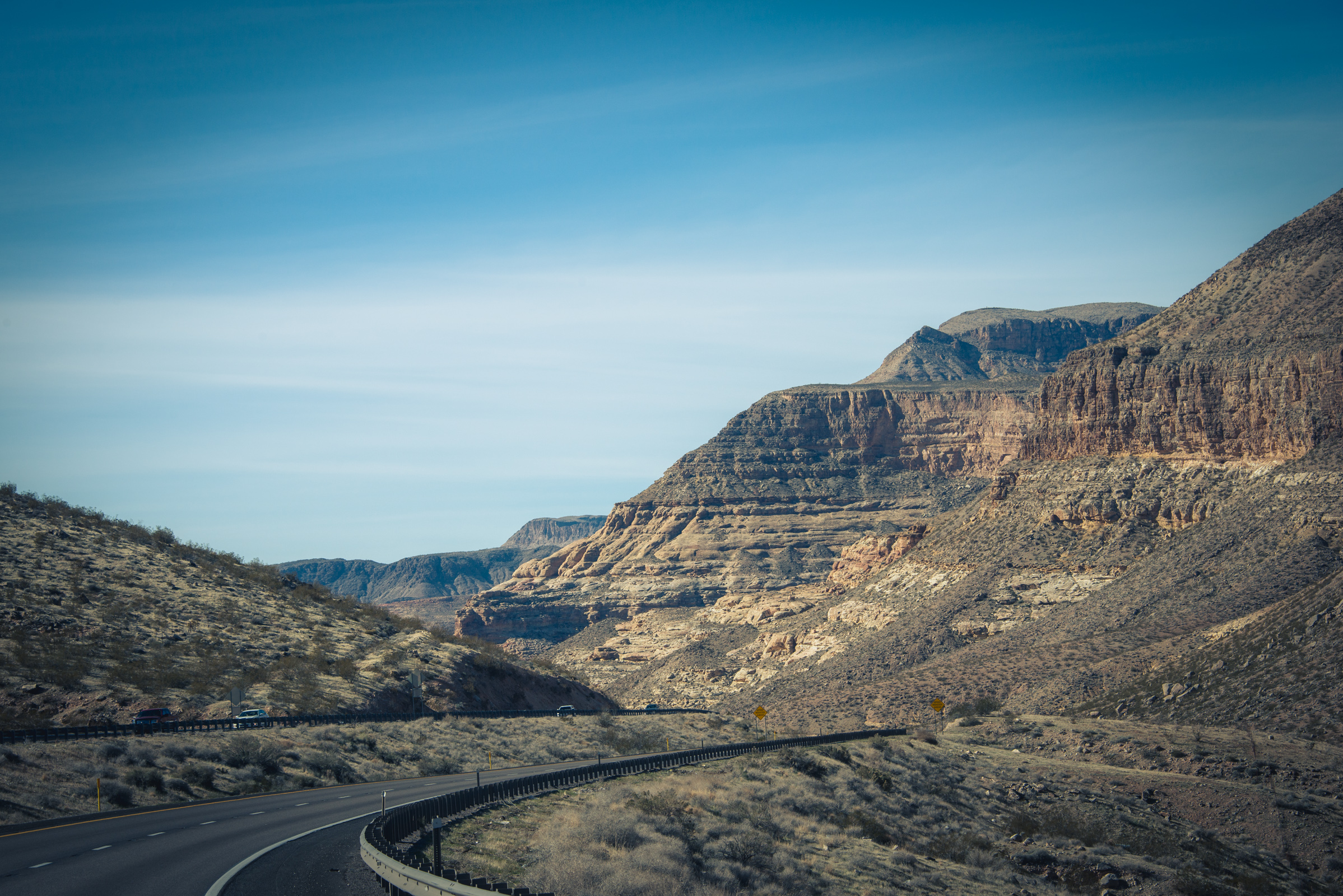road through the bluffs somewhere between utah and nevada, photographed by jamie bannon photography.