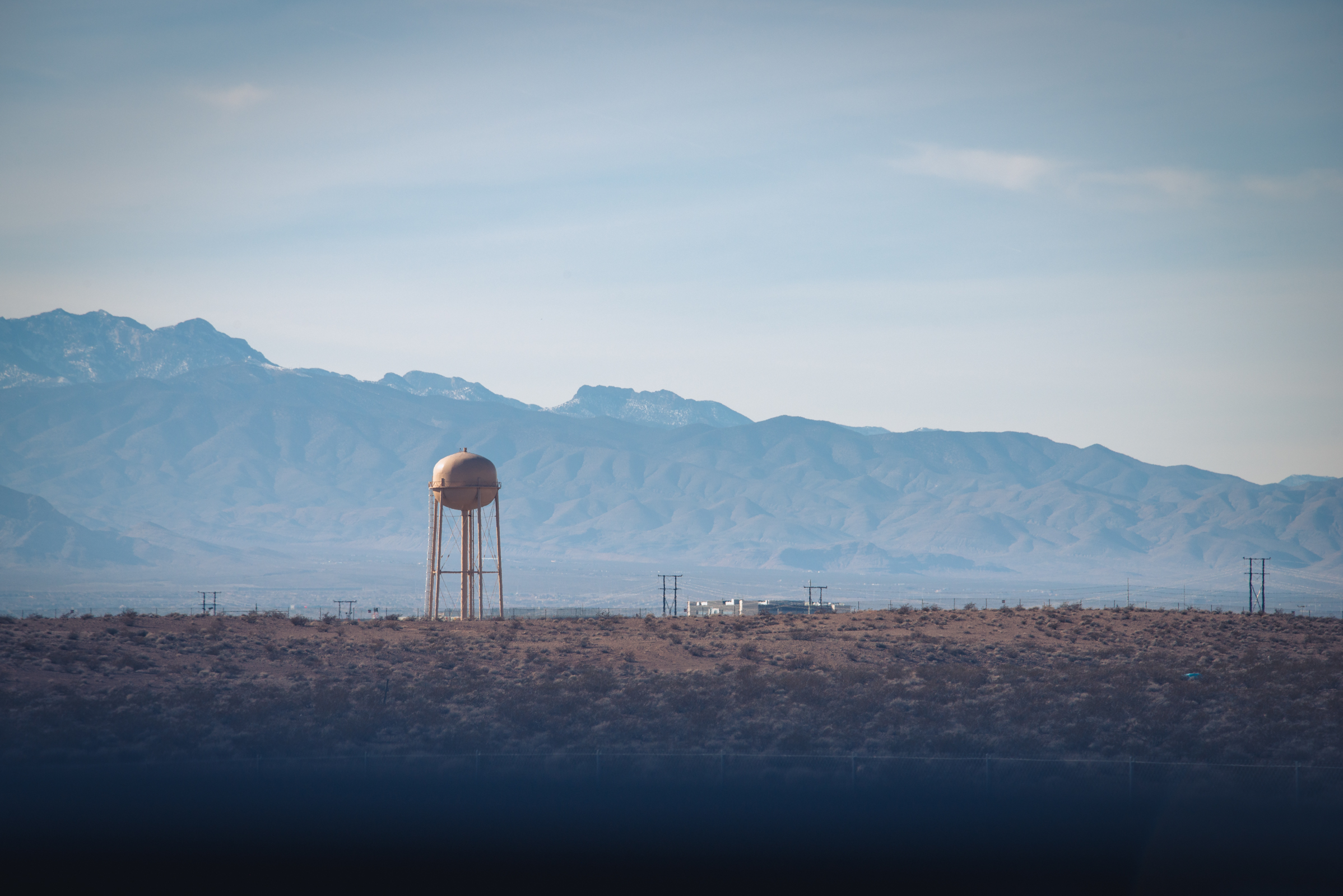 roadside landscape with a water tower somewhere between utah and nevada, photographed by jamie bannon photography.