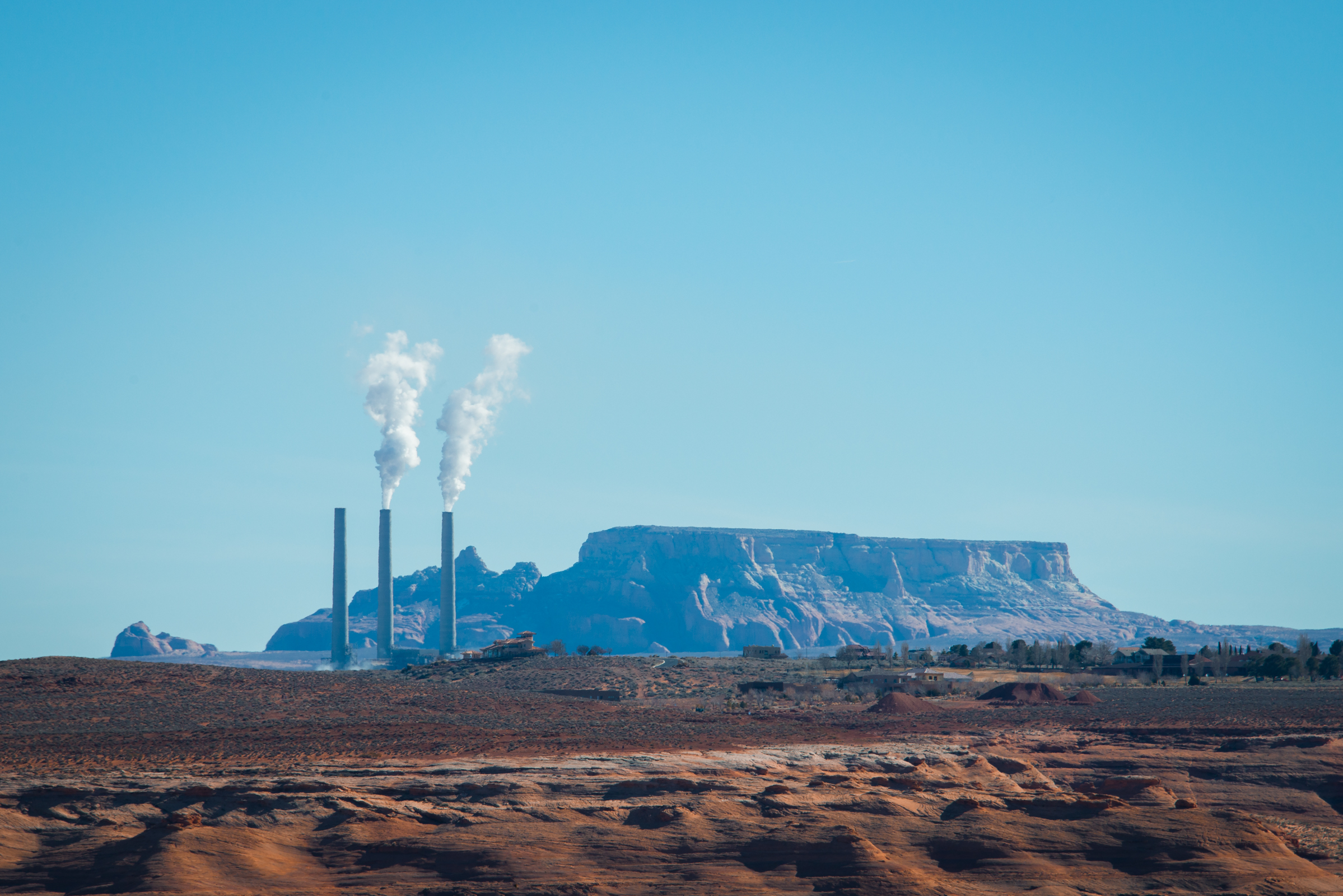 roadside landscape with smokestacks somewhere between utah and nevada, photographed by jamie bannon photography.