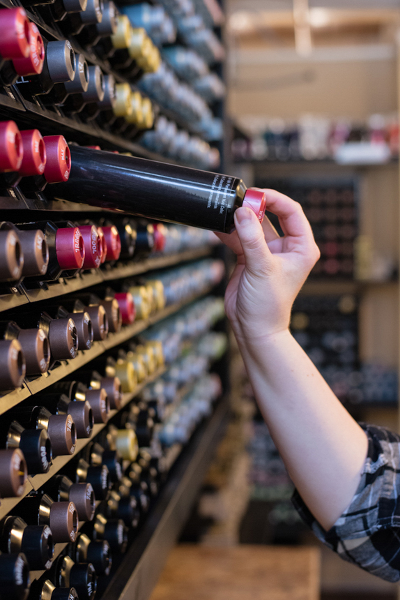 a salon stylists reaches for a bottle of color, photographed as part of a brand shoot by jamie bannon photography.