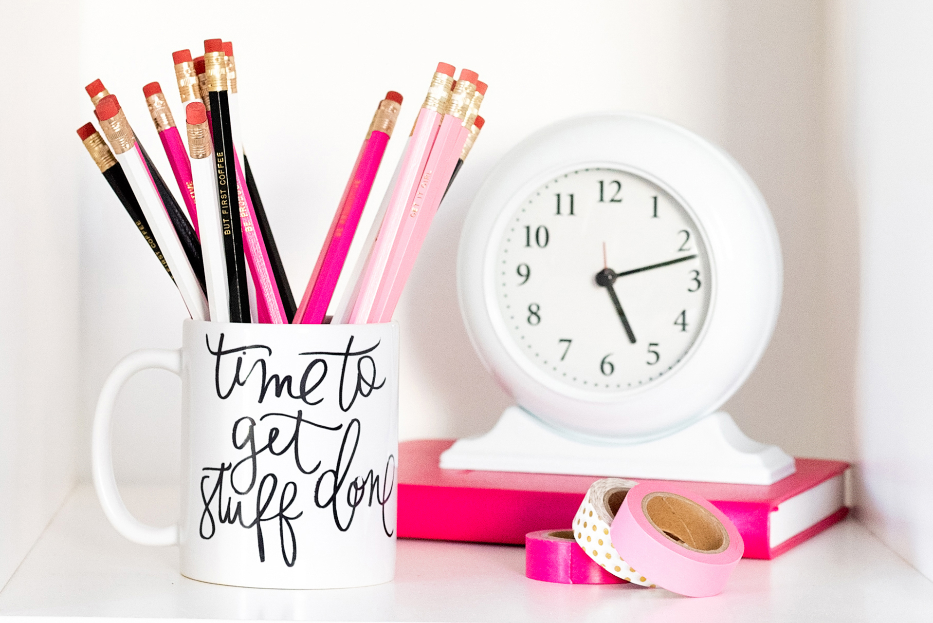 "detail of a mug reading ""time to get stuff done"" with a clock, photographed by jamie bannon photography."