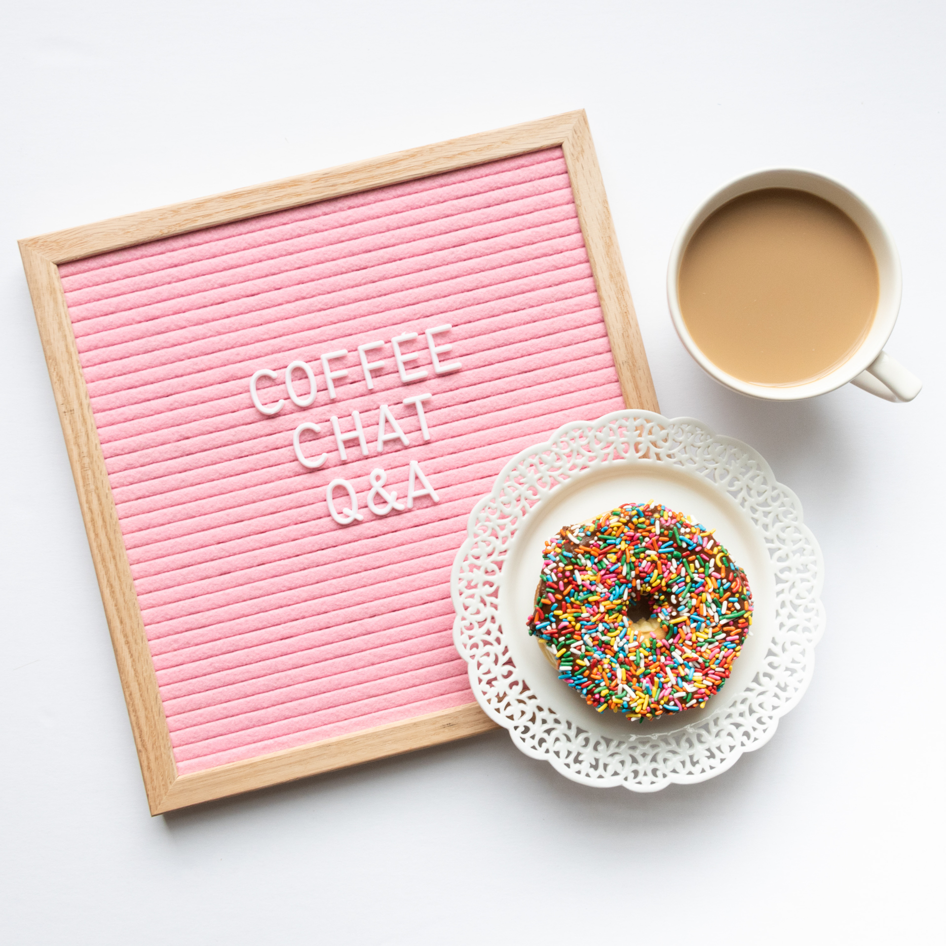 flat lay with a letter board, coffee cup, and donut, photographed by jamie bannon photography.