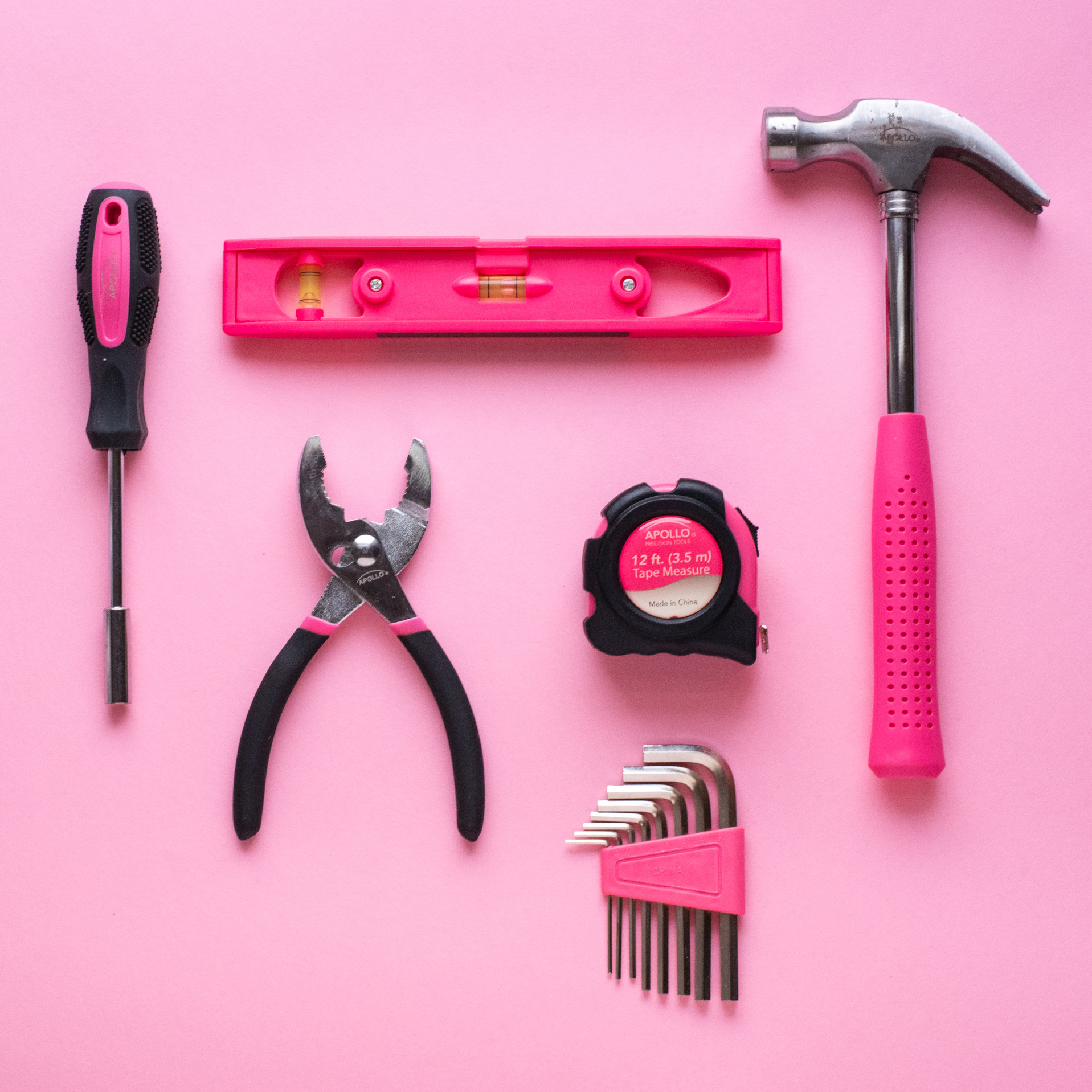 flat lay with pink tools, photographed by jamie bannon photography.