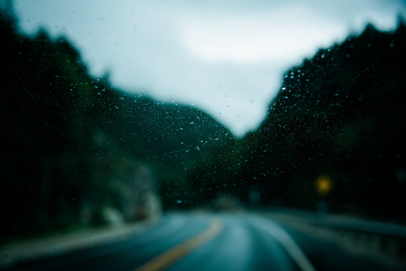 driving on the kancamagus highway through the white mountains in new hampshire, photographed by jamie bannon photography.