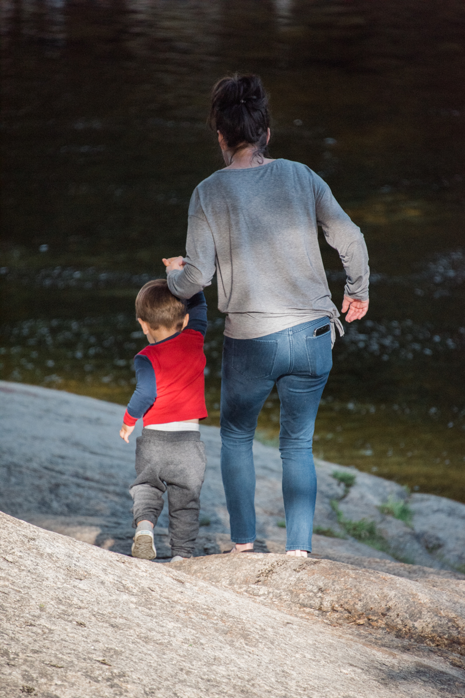 grandma and grandson walk down to the pemigewasset river in new hampshire, photographed by jamie bannon photography.
