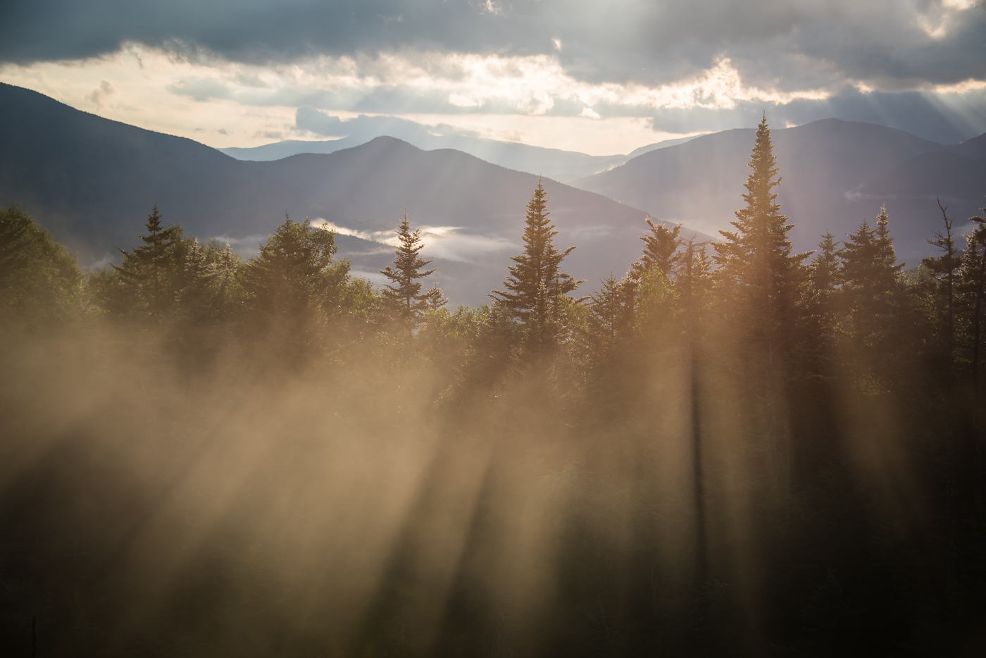 a beautiful sunset on the kancamagus highway in the white mountains, new hampshire, photographed by jamie bannon photography.